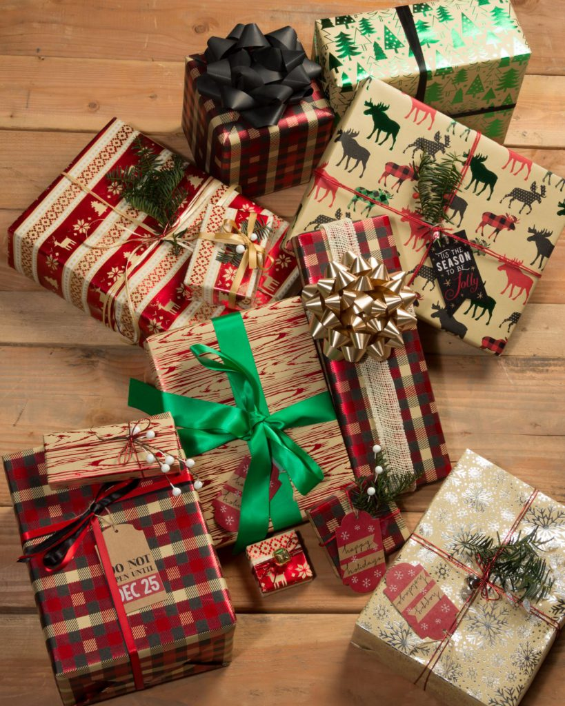 kraft-wrapped presents in red and green with ribbons
