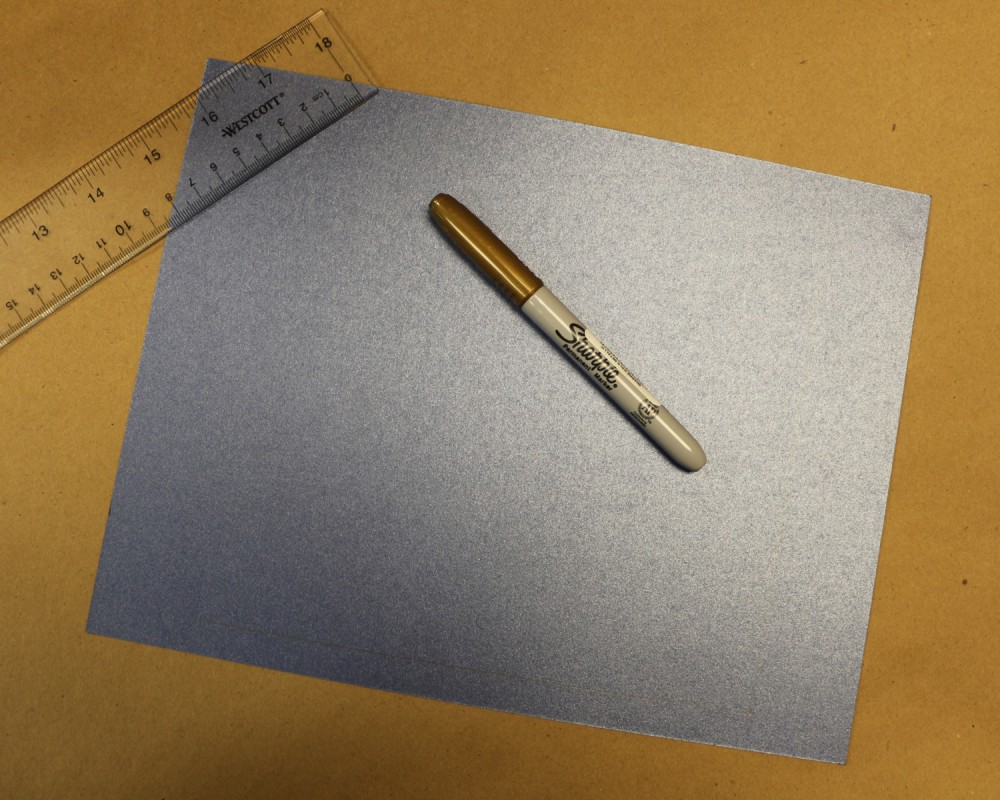 materials for DIY checkers: blue card stock, ruler, gold Sharpie