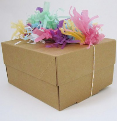 box with colorful tissue paper shreds on top