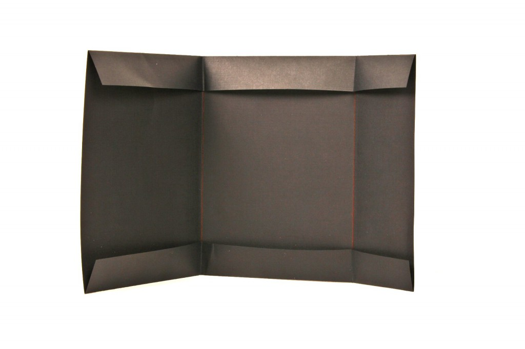brown metallic paper envelope folded and laid out