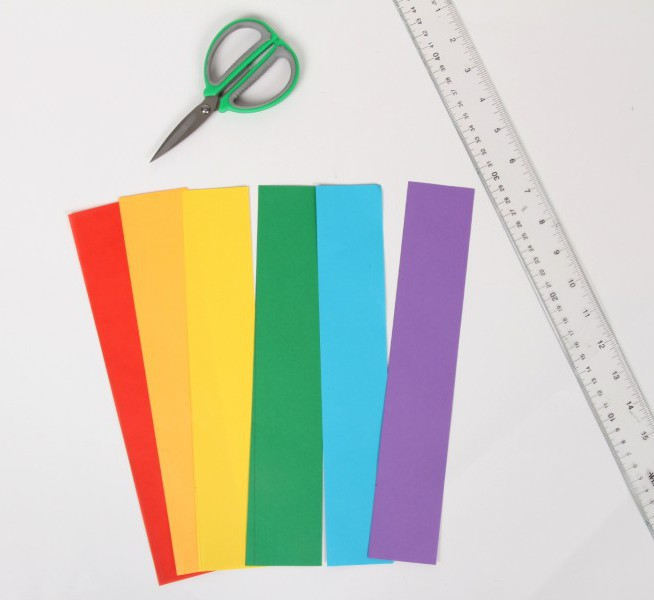 rectangle strips of rainbow multicolored paper with scissors and clear ruler