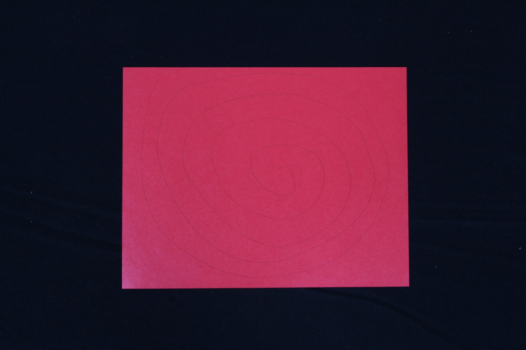 Red paper, spiral drawn on