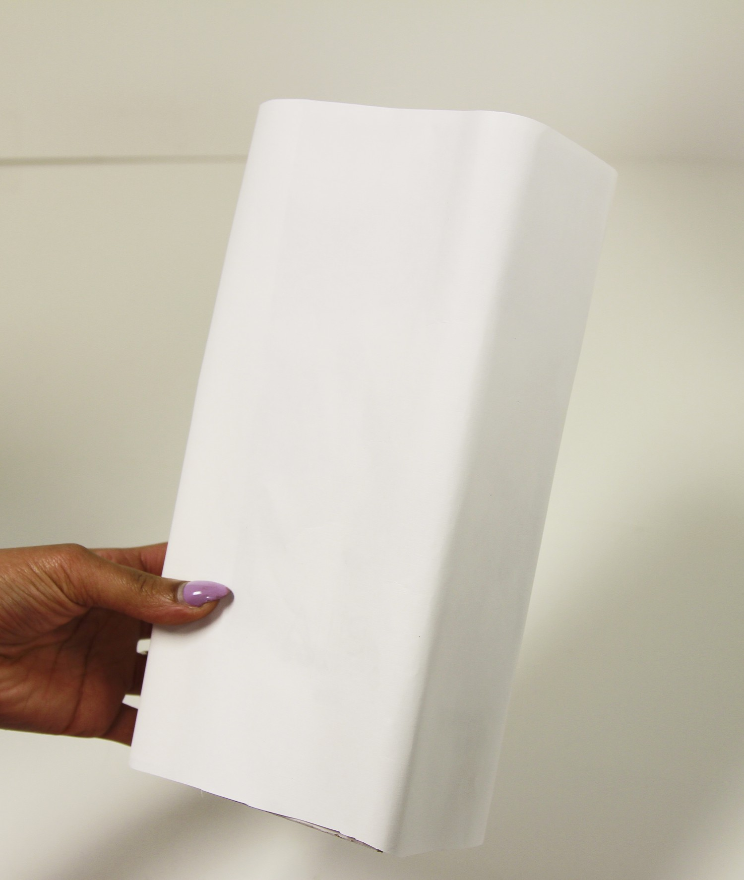 box covered with white paper