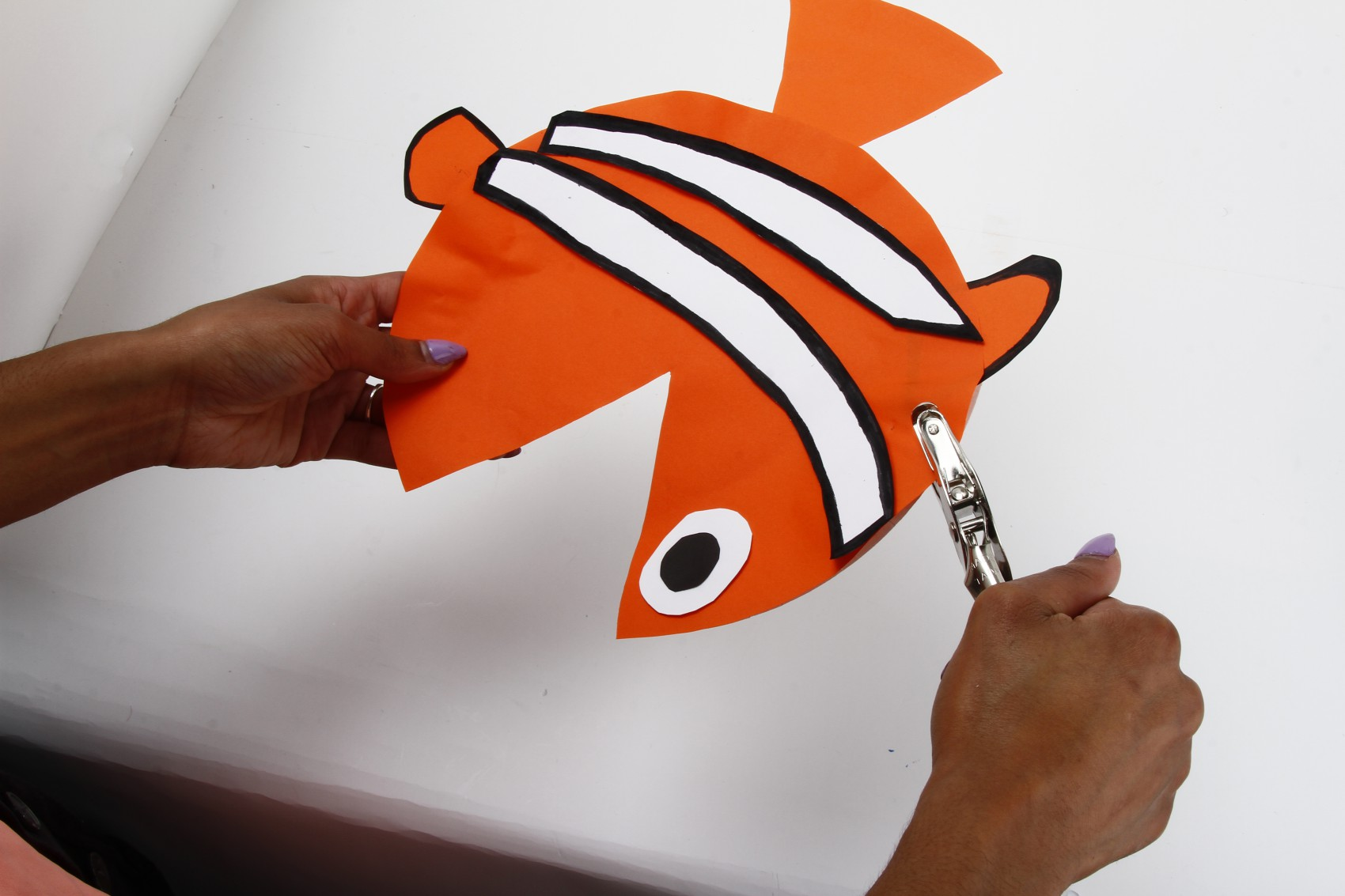 punching hole in paper fish