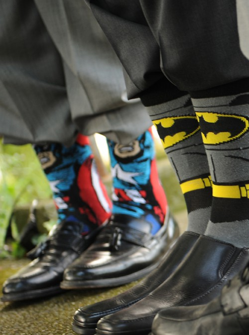 tux pants and dress shoes with super hero long socks pulled up