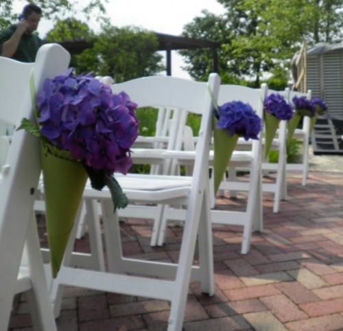 Purple flowers in cones on chairs
