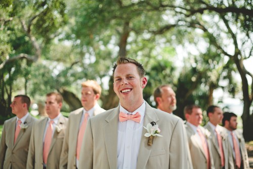 groom in pink bowtie and groomsmen in matching suits with pink ties