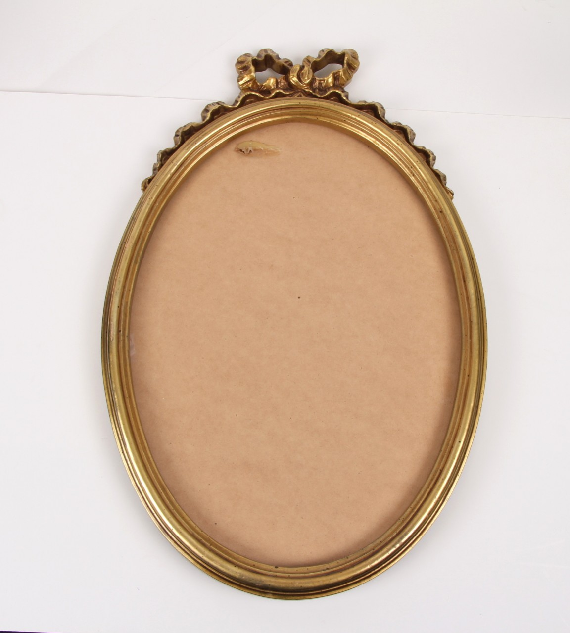 gold mirror frame with ribbon design on top no glass