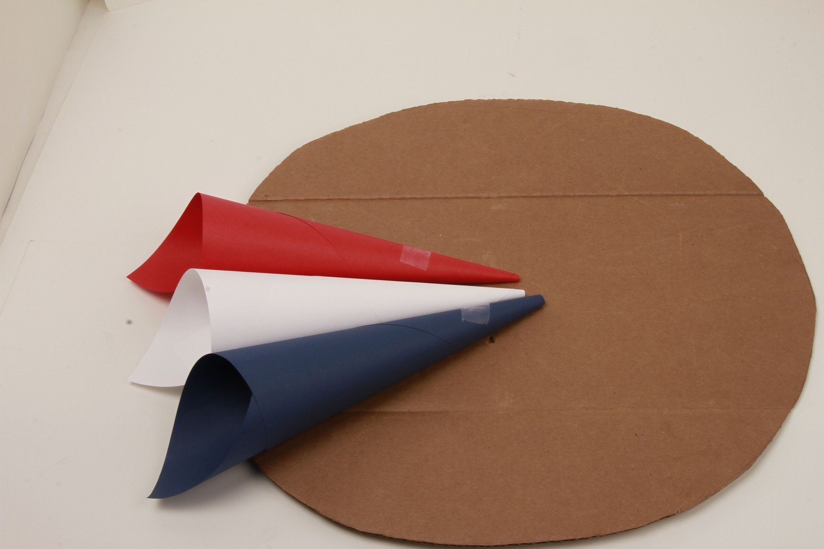 red, white, blue paper cones taped to cardboard circle