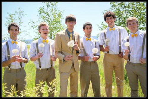 men in matching green and khaki dress outfits with yellow bowties in field