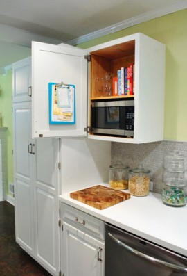 open white kitchen cupboard with grocery list on clipboard