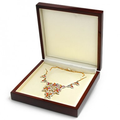 jeweled necklace displayed in open wooden jewelry box