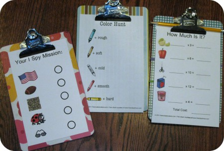 three designed clipboards with children's learning exercises