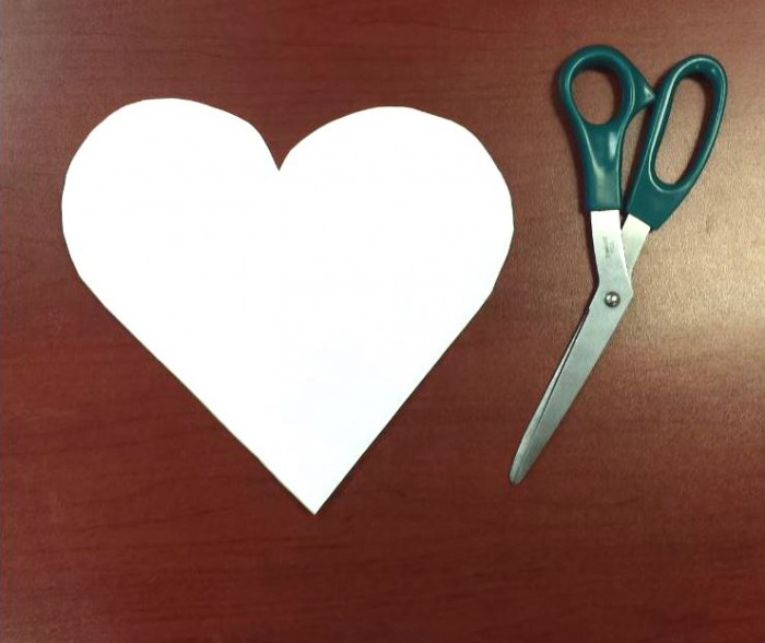 white labor day paper craft heart cutout with pair of scissors on desk