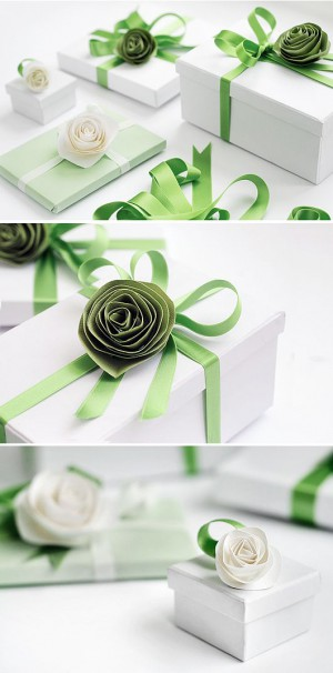 White gift boxes with paper flowers and ribbon