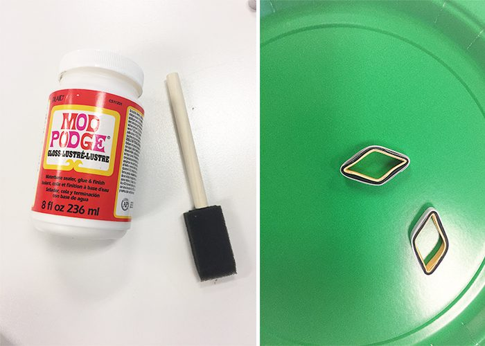 foam brush and bottle of mod podge with green plate and paper earrings