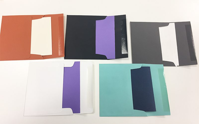 Assorted colored envelopes on a white background