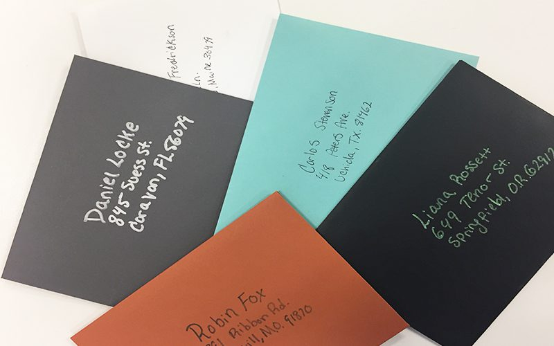 Addressed envelopes in different colors