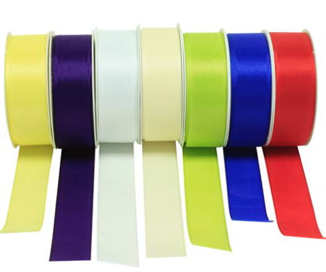 Colorful ribbons multicolored rolls in a row