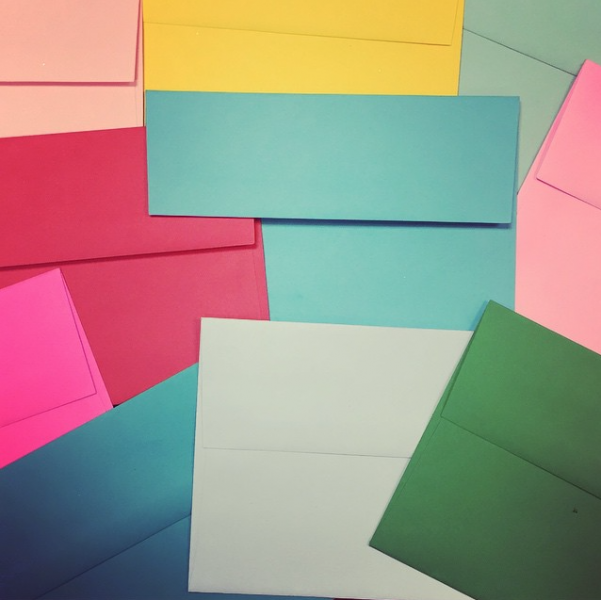 multicolored colorful envelopes office supply close up