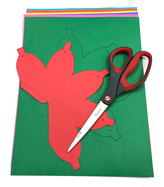 Scissors and card stock paper - Christmas light shape cut out of card stock
