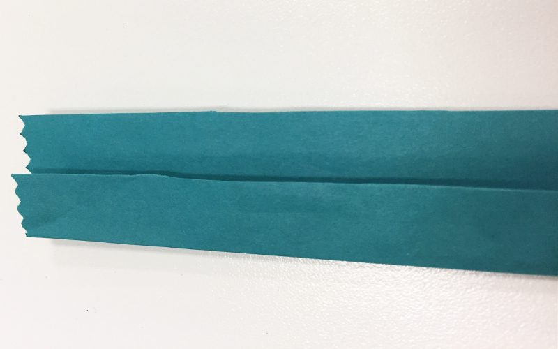 Make DIY Drink Coasters from Warpping Paper Scraps, strip of paper, fold, crease, teal wrapping paper, blue
