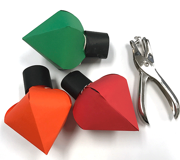 Christmas lights with hold puncher, used to punch two holes in black strip