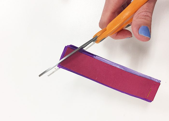 Close the fan and cut the corner with scissors