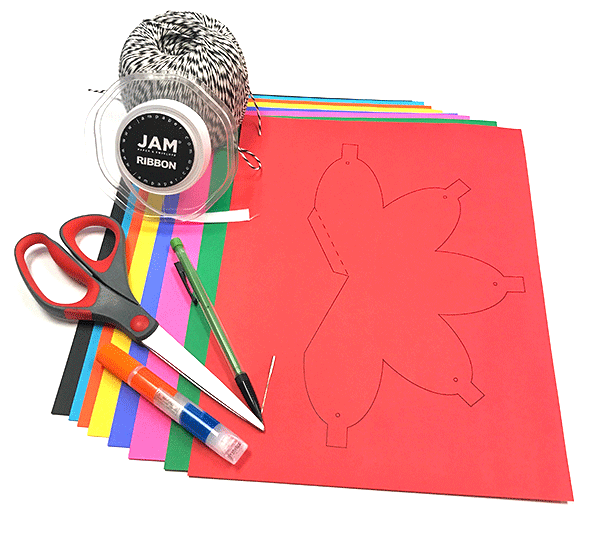 Art supplies for DIY Christmas lights - colored card stock paper, glue, twine, ribbon, pencils, scissors