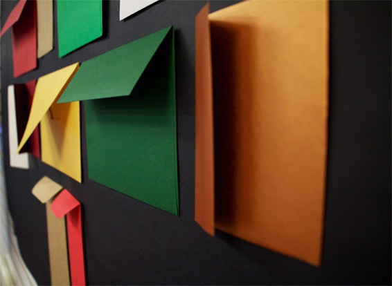 colored envelopes on black wall background