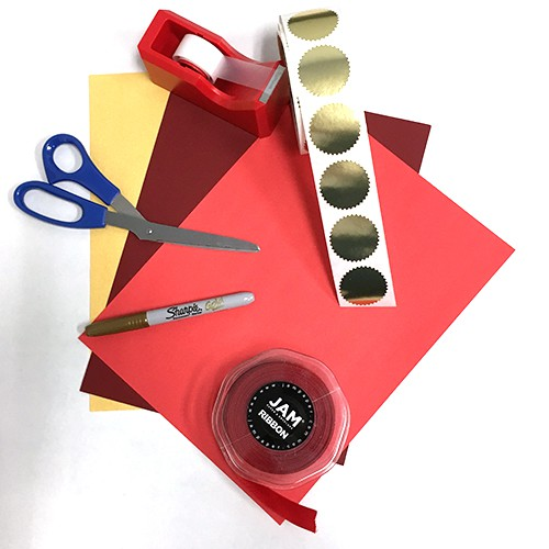 red carpet ready materials - red paper, gold paper, red ribbon, gold sharpie, scissors, tape, gold stickers