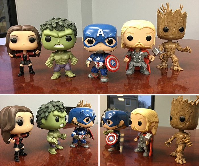 avengers bobblehead collection lined up on desktop for stress free office space