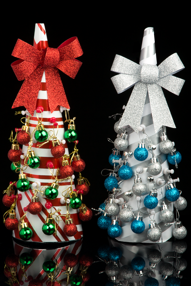 colorful striped diy tabletop christmas trees with tiny ornaments and glitter bows