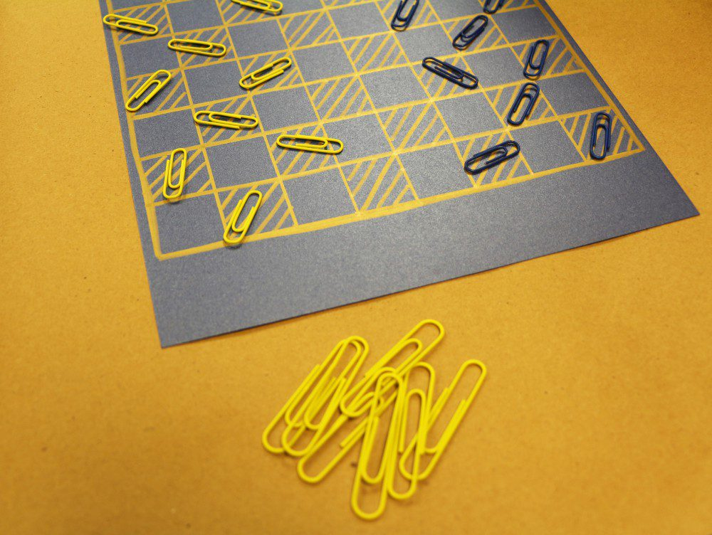 summer fun black and yellow diy paper clip checkerboard on yellow floor