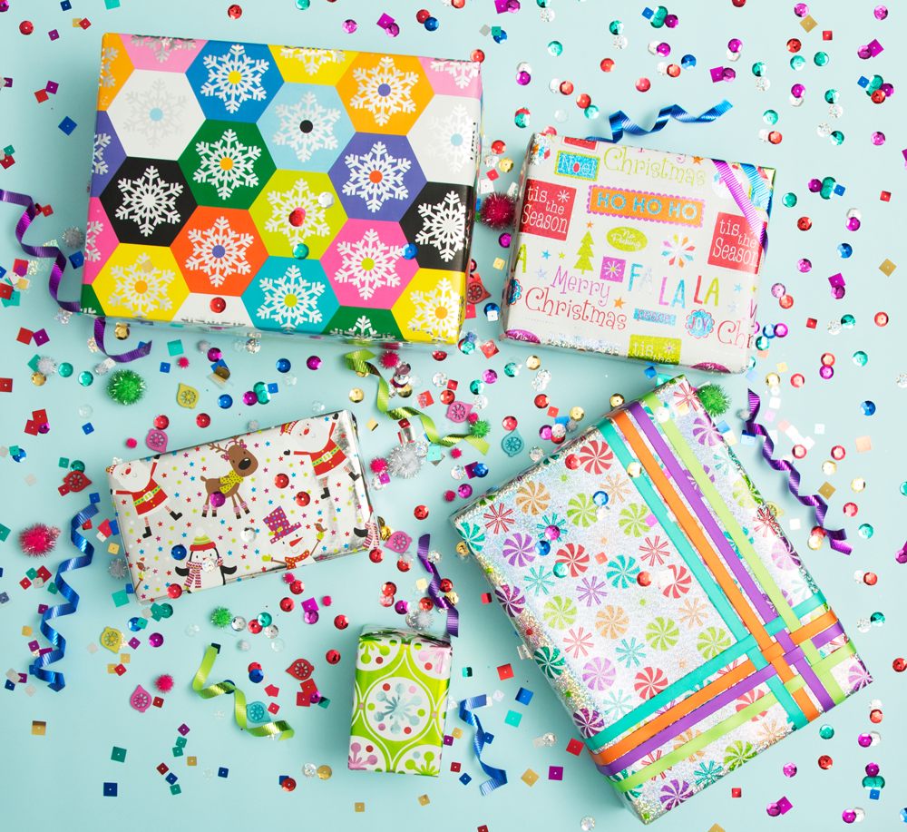 holiday wrapping trend 2: 5 multicolored wrapped holiday presents with rainbow confetti