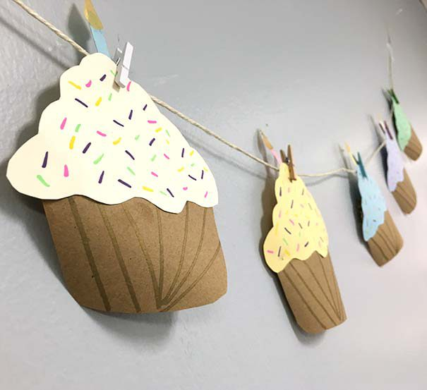 paper cupcakes clipped to twine with clothespins