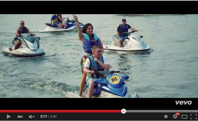 cool for the summer Gold wafer seal on Demi Lovato jet ski