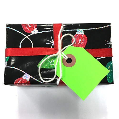 Name tag attached to gift ribbon with twine