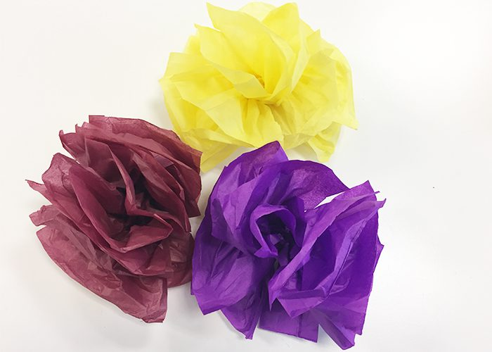 Completed yellow, burgundy, and purple pompom flowers