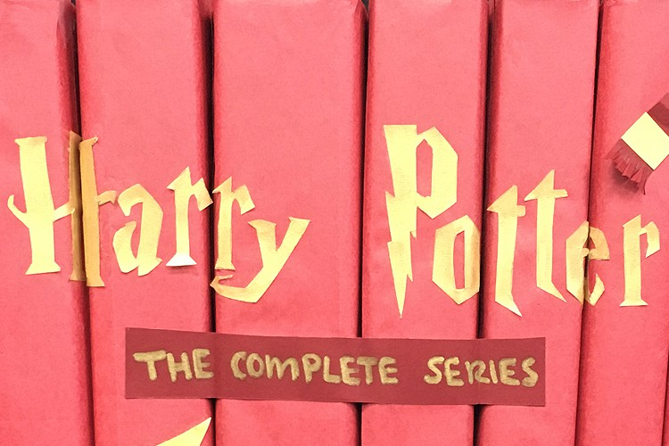 """""""harry potter"""" in gold translucent paper glued to books"""