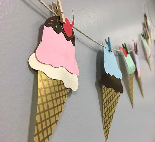 paper ice cream drawings clipped to twine with clothespins