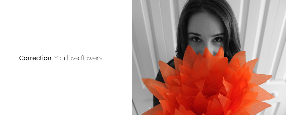 "girl holding orange tissue flower - ""correction: you love flowers"""