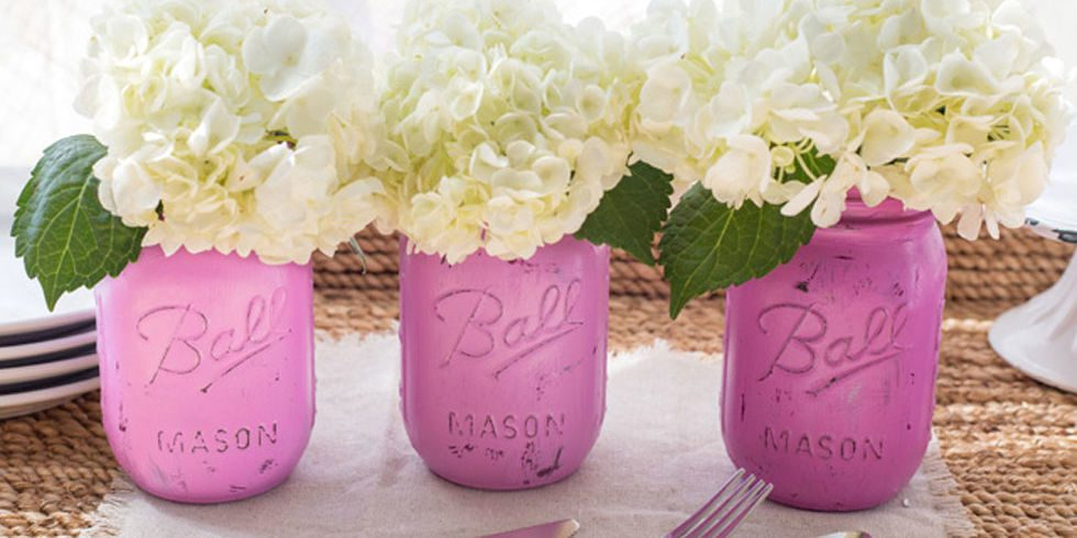 lavender purple painted mason jar vases with large white flowers