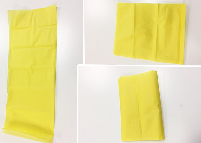Yellow tissue paper folded in half