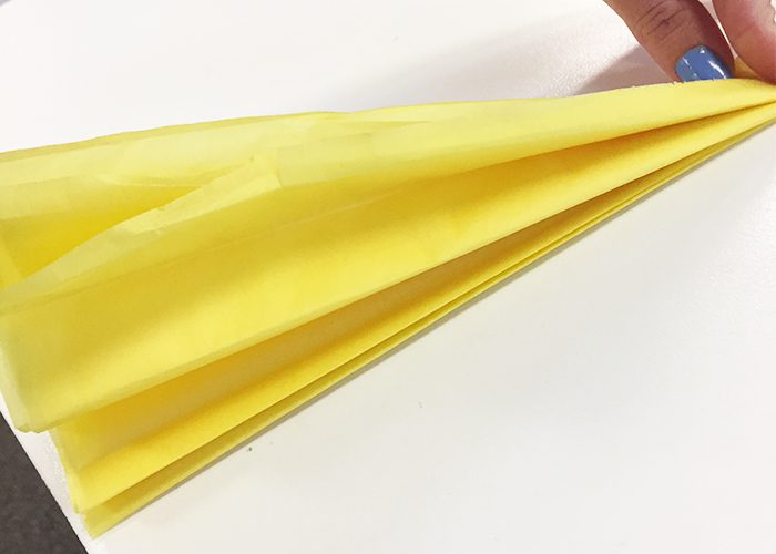Accordion folds in yellow tissue paper