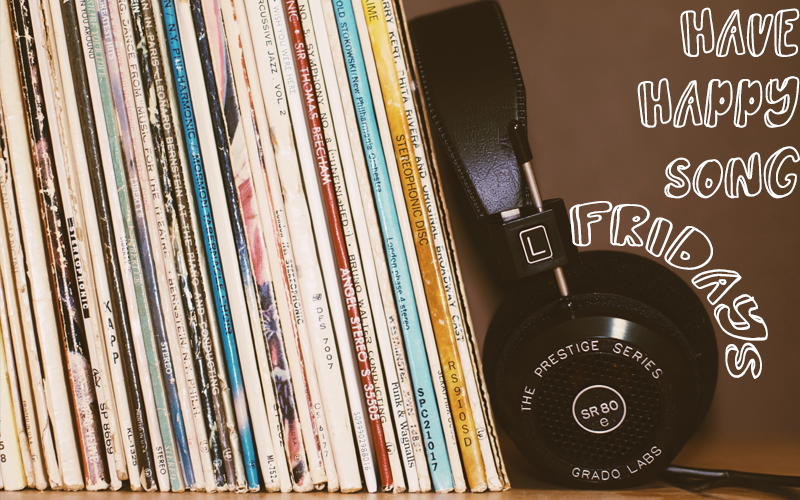 """Stack of records and a pair of headphones on a shelf with caption """"Have Happy Song Fridays"""""""