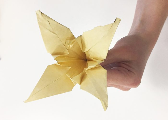 How To Make Paper Origami Easter Lilies, flower, lily, completed, holding, antique gold