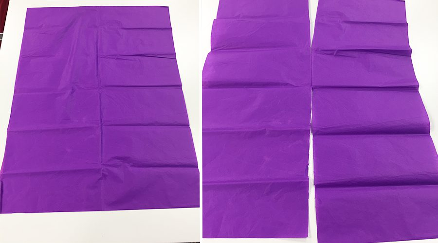 Purple tissue paper cut in half long ways, halves placed on top of one another