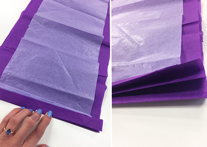 Accordion folds in purple and white tissue paper