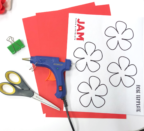 How to Make Paper Roses, hot glue, scissor, binder clip